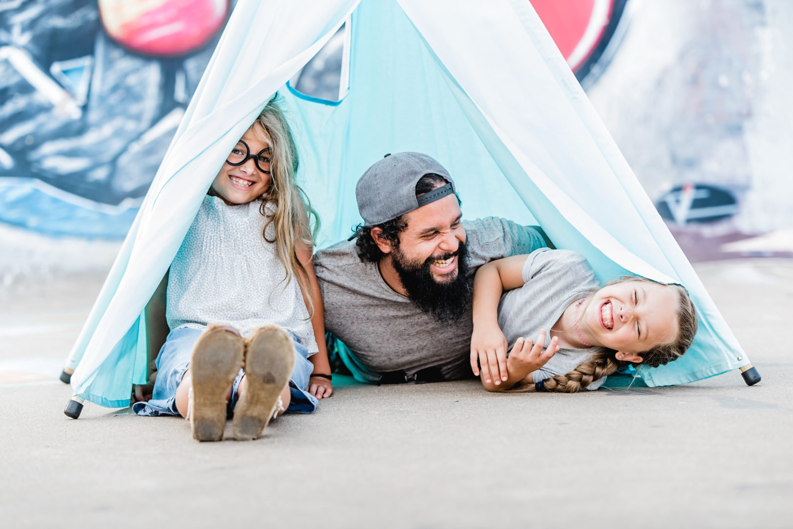 family inside blue teepee play tent
