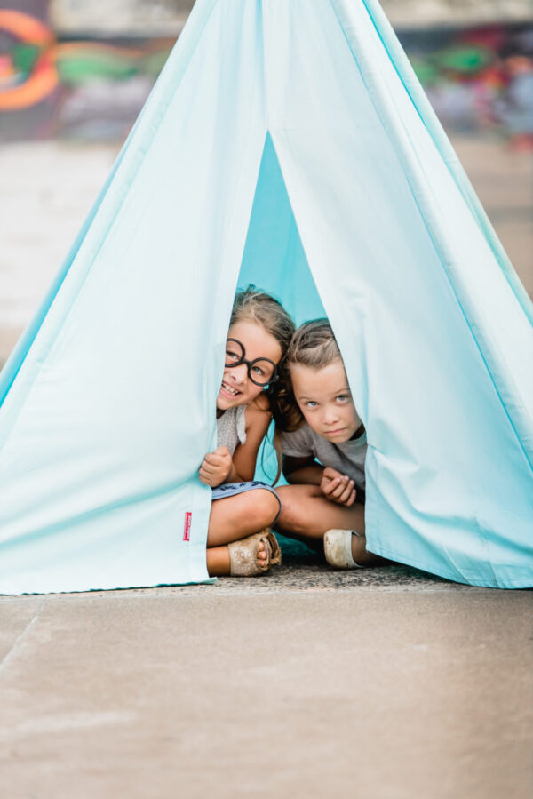 Kids peeking through turquoise blue teepee play tent